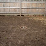 "Drainage - 15"" catch basin installed in rear yard"