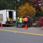 Sewer Work - MDC installing tap in water line
